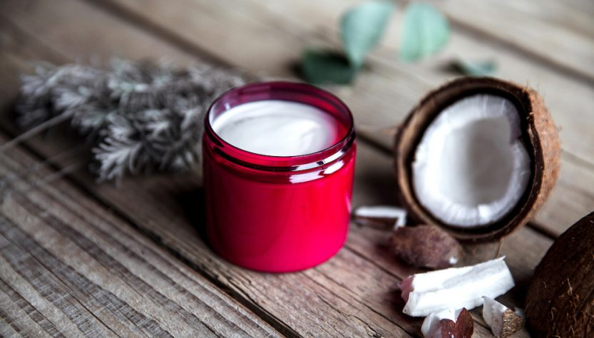 Organic cream on wooden background. Conditioner, shampoo for hair care. Natural cosmetics. Healthy skin and hair. and