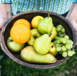 Fresh fruit. Farmer with bowl of fruit.s. Fruit basket.